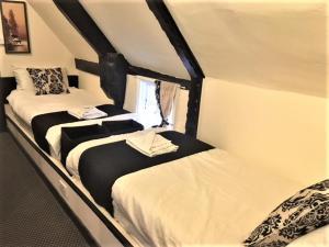 Säng eller sängar i ett rum på Avon Accommodation
