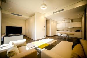 A seating area at M Executive Hotel and Residence - Adults Only