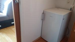 Kuhinja oz. manjša kuhinja v nastanitvi Apartment Slavica