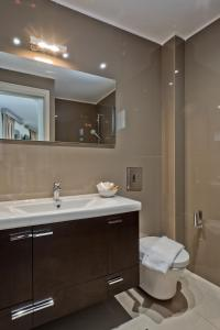 A bathroom at Nereus Luxurious Suites