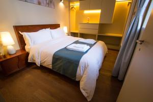 A bed or beds in a room at Orion ODM Lisbon 8 Building Apartments