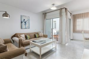 A seating area at Valle Romano Golf Apartment