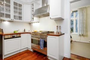A kitchen or kitchenette at Apartment Elisenbergveien