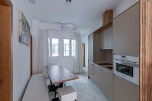 Una cocina o zona de cocina en Casa Gloria Apartments