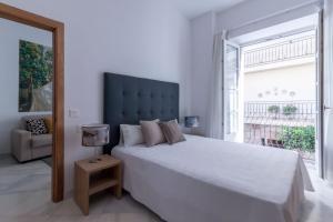 Cama o camas de una habitación en Casa Gloria Apartments