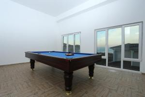 A pool table at Basha Villas