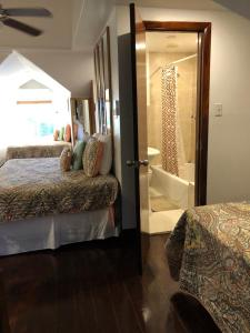 A bed or beds in a room at The Oasis Retreat