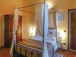 Letto o letti in una camera di Podere Montepulciano