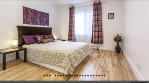 Un ou plusieurs lits dans un hébergement de l'établissement Apartment Condotel Montreal