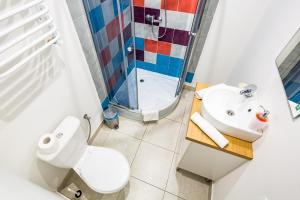Ванна кімната в Dominic Apartments