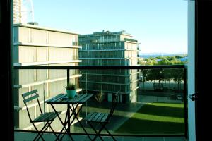 A balcony or terrace at Great flat, nice view, steps away from everything