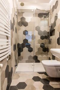 A bathroom at udanypobyt Apartament Skocznia