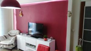 A television and/or entertainment center at One Bedroom Apartment in Kusadasi City Center