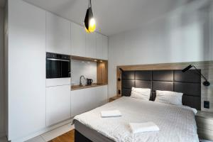 A bed or beds in a room at Executive Suites MODUO