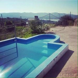 The swimming pool at or near Casa Con Piscina Y Vista Al Lago