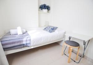 A bed or beds in a room at Sitito Good Life Apartment