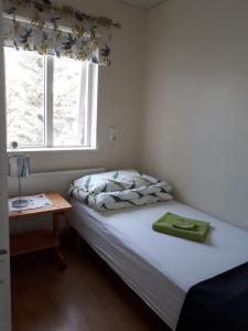 A bed or beds in a room at Brúnalaug Guesthouse - Holiday Home