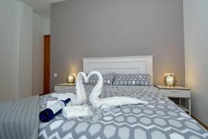 A bed or beds in a room at Apartamento El Pueblo