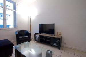 A television and/or entertainment center at Acropolis centre ville