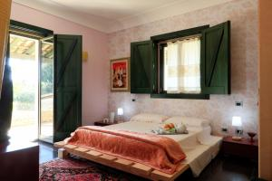 A bed or beds in a room at La Casetta Sicilian Cottage