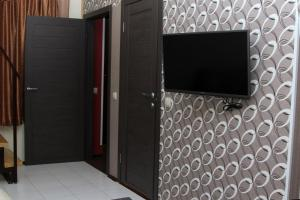Телевизор и/или развлекательный центр в Apart-Hotel Domodedovo