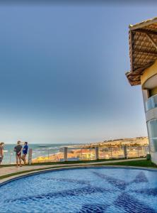 The swimming pool at or near Canoa Quebrada Luxury Residence
