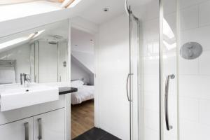 A bathroom at Harvist Road II by Onefinestay