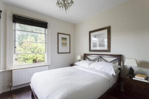 A bed or beds in a room at Harvist Road II by Onefinestay