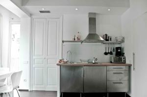 A kitchen or kitchenette at Barceloneta Apartments Market