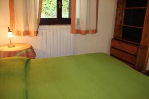 A bed or beds in a room at Casa Castagno
