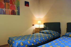 A bed or beds in a room at Casa Faggio