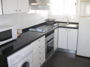 A kitchen or kitchenette at Bungalow Parte Alta