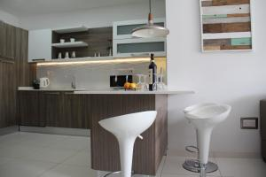 A kitchen or kitchenette at Interlace Apartment