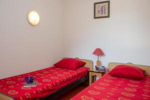 A bed or beds in a room at Résidence Goélia Les Balcons d'Anaïs