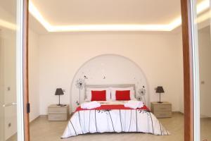 Un pat sau paturi într-o cameră la MiraSorrento
