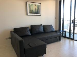 A seating area at Hurstville New apartment with city view