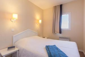 Un ou plusieurs lits dans un hébergement de l'établissement Résidence Pierre & Vacances Le Thabor