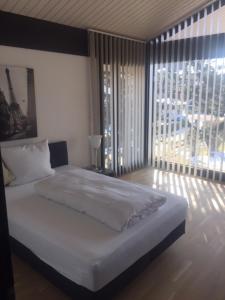 Ein Bett oder Betten in einem Zimmer der Unterkunft Residence
