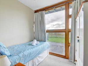 A bed or beds in a room at Meadow View