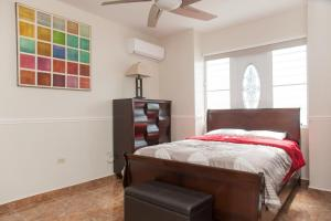 A bed or beds in a room at Big vacational house in Isabela / Aguadilla