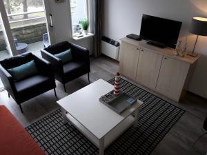 Ein Sitzbereich in der Unterkunft Hollumerstrand