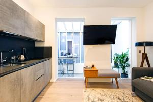 A television and/or entertainment center at ARCORE Premium Apartments: Monmouth Street
