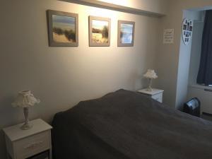 Een bed of bedden in een kamer bij Apartment Havenzicht