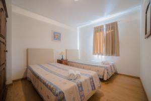 A bed or beds in a room at Marina Buzios by Garvetur