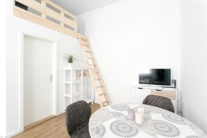 A television and/or entertainment center at Studio Apartment for 3