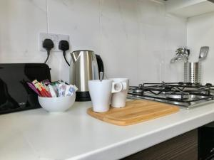 A kitchen or kitchenette at Quora Meadows