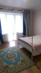 Кровать или кровати в номере Таунхаус