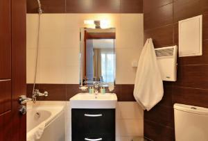 Un baño de Apart Hotel Golden Line