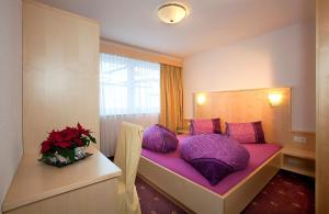 Cama o camas de una habitación en Haus Alpenflora