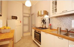 A kitchen or kitchenette at Casa Ilaria